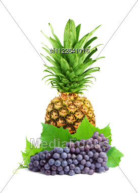 Ripe pineapple and Bunch of fresh grapes isolated on a white background Stock Photo