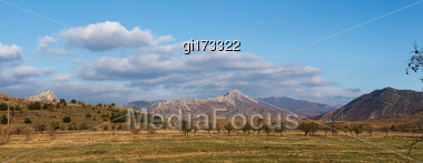 Running Storm Clouds On A Background Of Mountains. Panorama Stock Photo