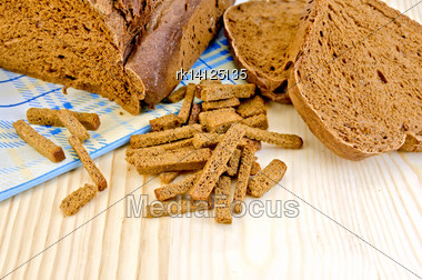 Rye Homemade Bread, Crackers, Blue Cloth On A Background Of Wooden Boards Stock Photo