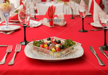 Salad Of Fresh Vegetables, Served On The Table. Style Tricolor - Red, White, Black Stock Photo