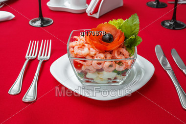 Seafood Salad With Shrimps And Fresh Vegetables, On A Serving Table. On A Red Tablecloth Close-up Stock Photo