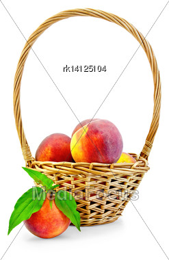 Several Whole Peaches, Green Leaves, Wicker Basket Isolated On White Background Stock Photo