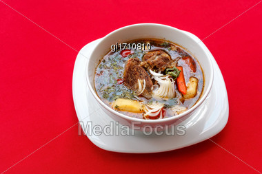 Soup With Meat And Sour Cream On A Red Tablecloth. View From Above Close-up Stock Photo