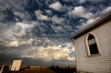 Storm Clouds Saskatchewan With Country Church At Sunset Stock Photo
