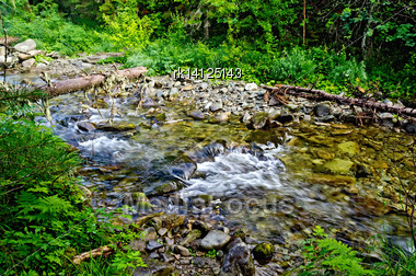 Stormy Mountain River Zhigalan On The Ridge Kvarkush On The North Of The Ural Mountains On The Background Of Green Vegetation Stock Photo