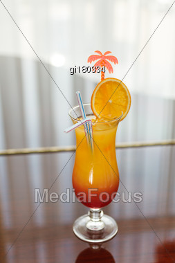 Tequila Sunrise Cocktail On The Window Background Stock Photo