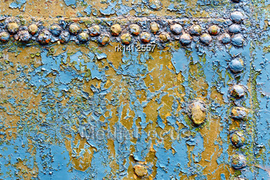 Texture Of A Rusty Blue Metal Door With Rivets Stock Photo