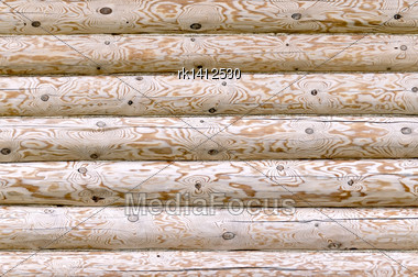 Texture Of Stacked Logs In The Wall Of A House Close-up Stock Photo