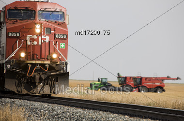 Train And Combine Prairie Scene Saskatchewan Canada Stock Photo
