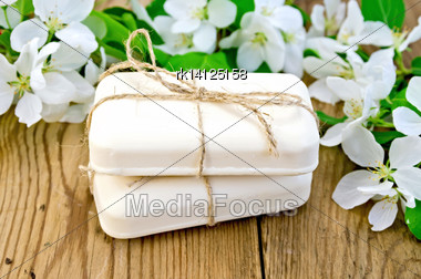 Two Bars Of Soap With White Flowers Of Apple Trees On The Background Of Wooden Boards Stock Photo