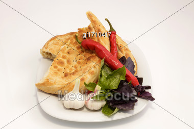 Vegetables And Red Hot Pepper, On A Plate With A Slice Of Bread Stock Photo