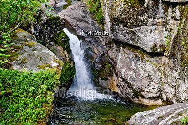 Waterfall On The River Zhigalan On A Ridge Kvarkush In The North Of The Ural Mountains Stock Photo