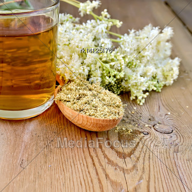 Wooden Spoon With Dried Flowers, A Bouquet Of Fresh Flowers Of Meadowsweet, Tea In Glass Mug On The Wooden Boards Stock Photo