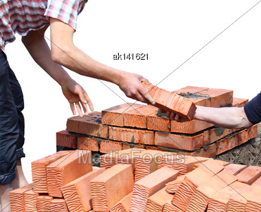 Workers Laid Red Bricks. Close-up. Isolated On White Background Stock Photo