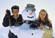 Couples Lifestyle vacation winter snow Snowman recreation relaxing stock photo
