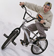 child bicycles bike biking bmx trick stock photo