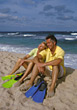 Couples Lifestyle sand relax relaxing people couples sit stock photo