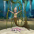 3D Digital Render Of Alittle Cute Baby Mermaid On Blue Fantasy Ocean Background