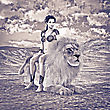 3D Digital Render Of A Beautiful Young Woman And A Lion On A Desert Landscape Background