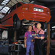 Auto car shop garage male bluecollarworker adult stock photo
