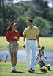 golfcourse golfing golfer sport leisure couple stock image