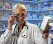 medication pharmacy prescription profession 30s women stock photo