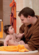 babies bathe dad bathing girl daughter stock photo