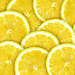 Abstract Background With Citrus-fruit Of Lemon Slices. Close-up. Studio Photography