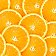 Abstract Background With Citrus-fruit Of Orange Slices. Close-up. Studio Photography