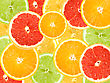 Abstract Background Of Citrus Slices. Close-up. Studio Photography stock photo