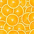 Abstract Background Of Heap Fresh Orange Slices. Seamless Pattern For Your Design. Close-up. Studio Photography.