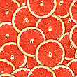 Abstract Background Of Heap Fresh Red Grapefruit Slices. Seamless Pattern For Your Design. Close-up. Studio Photography.