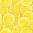 Abstract Background Of Heap Fresh Yellow Lemon Slices. Seamless Pattern For Your Design. Close-up. Studio Photography.