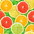 Abstract Background With Motley Citrus-fruit Slices And Green Leaf With Dew. Seamless Pattern For Your Design. Close-up. Studio Photography.