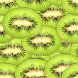 Abstract Background With Slices Of Fresh Ripe Green Kiwi. Seamless Pattern For Your Design. Close-up. Studio Photography.