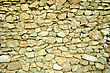 Abstract Background Of Stone Wall. Close-up. Outdoor Photography