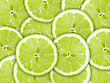 Repeat Abstract Green Background With Citrus-fruit Of Lime Slices. Close-up. Studio Photography stock photo