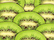 Abstract Green Background With Raw Kiwi Slices. Close-up. Studio Photography stock photography