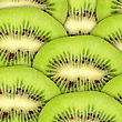 Abstract Green Background With Raw Kiwi Slices. Close-up. Studio Photography stock photo