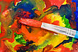 Abstract Painting. Paintbrush On Colorful Painted Paper stock photo