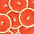 Abstract Red Background With Citrus-fruit Of Grapefruit Slices. Close-up. Studio Photography stock photo