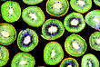 Abstract Slice Of Kiwi On Black Background(as Wallpaper Or Backdrop stock photo