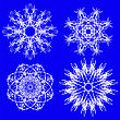 Abstract Snow Flakes Set Isolated On Blue Background
