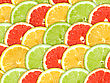 Abstract Three-color Background With Citrus-fruit Of Grapefruit, Orange And Lemon Slices. Close-up. Studio Photography stock photo