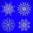 Abstract Winter Snow Flakes Set Isolated On Blue Background