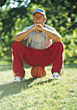 Active Senior Sitting on Basketball stock image