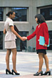 African-American and Asian Business Women Shaking Hands