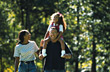 African American Family Walking in Park stock photography