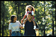 African American Family Walking in Park stock image