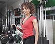 Athletic African American Woman Wearing A Red Doing Arm Exercises In The Gym stock photo